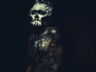 Zulu, wild man with white painted face and full body black paint