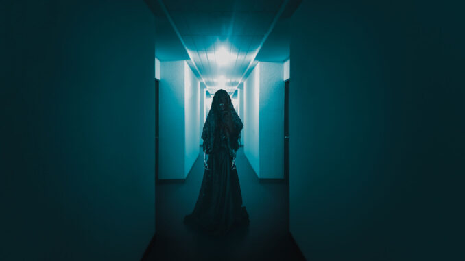 High contrast image of a scary ghost in a creepy hotel corridor